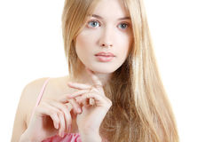Beautiful woman face closeup with long blond hair Royalty Free Stock Image