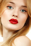 Beautiful woman face closeup with long blond hair and vivid red Stock Photos