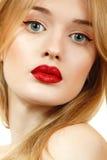 Beautiful woman face closeup with long blond hair and vivid red Stock Photos