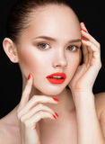 Beautiful woman face closeup over black background. Beautiful Pe Stock Image