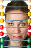 The beautiful woman face and color abacus Royalty Free Stock Photography
