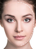 Beautiful woman face with correction line. Stock Images