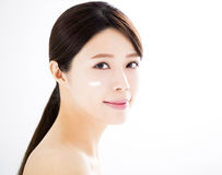 Beautiful woman face with cosmetic cream. Asian beautiful woman face with cosmetic cream Royalty Free Stock Photos