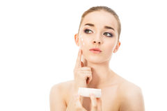 Beautiful woman with face cream isolated. Beautiful woman with face cream Stock Images