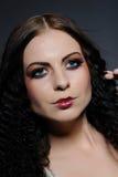 Beautiful woman face with creative make-up Stock Photos