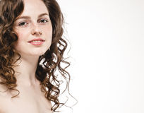 Beautiful woman face with curly flying hair studio on white Royalty Free Stock Photos