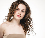 Beautiful woman face with curly flying hair studio on white Stock Image