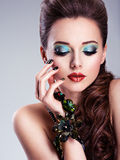 Beautiful woman face with fashion green make-up Royalty Free Stock Image