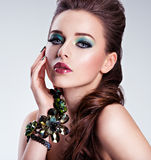 Beautiful woman face with fashion green make-up Royalty Free Stock Images