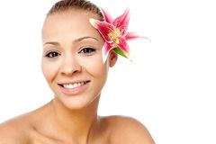 Beautiful woman face with fresh flower Royalty Free Stock Photos