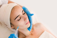 Beautiful woman face getting beauty injections Stock Photos