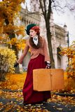 Beautiful woman face in the hat and red hair with luggage autumn travel. Countess voyage stock photos