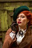 Beautiful woman face in the hat and red hair. With sad eyes - countess stock image
