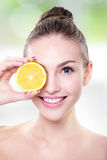 Beautiful woman face with juicy orange Stock Photo