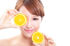 Beautiful woman face with juicy orange. Green background, asian beauty model Stock Images