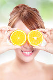 Beautiful woman face with juicy orange Royalty Free Stock Photos