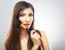 Beautiful woman face. Make up applying with brush. Stock Photo