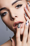 Beautiful Woman face with manicure nails royalty free stock image