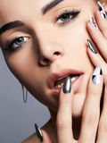 Beautiful Woman face with manicure nails stock photos