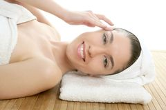Beautiful woman face massage with white towel Stock Images