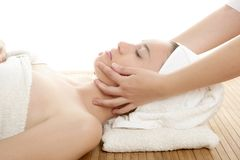 Beautiful woman face massage with white towel Stock Photo