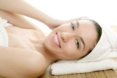 Beautiful woman face massage with white towel Royalty Free Stock Image