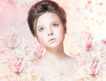 Beautiful Woman Face with Natural Makeup over Floral Rose Pattern Stock Photography