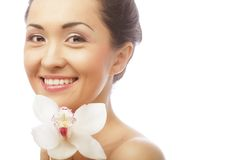 Beautiful woman face with  orchid flower Royalty Free Stock Photography