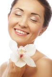 Beautiful woman face with  orchid flower Royalty Free Stock Photo