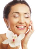 Beautiful woman face with  orchid flower Stock Photos