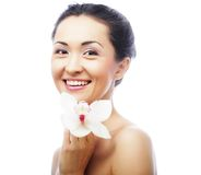 Beautiful woman face with orchid flower Royalty Free Stock Image
