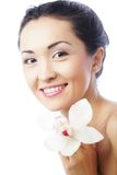 Beautiful woman face with orchid flower Stock Photo