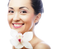 Beautiful woman face with orchid flower Stock Photography