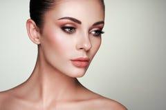 Beautiful woman face with perfect makeup stock photos