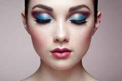 Beautiful woman face. Perfect makeup. Beauty fashion. Eyelashes. Lips. Cosmetic Eyeshadow Stock Photos