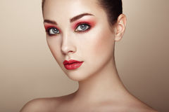 Beautiful woman face. Perfect makeup. Beauty fashion. Eyelashes. Lips. Cosmetic Eyeshadow. Perfect skin Stock Photos