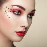 Beautiful woman face. Perfect makeup. Beauty fashion. Eyelashes. Lips. Cosmetic Eyeshadow. Perfect skin stock photography