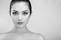 Beautiful woman face. Perfect makeup. Beauty fashion. Eyelashes. Lips. Cosmetic Eyeshadow. Perfect skin. Black and White Royalty Free Stock Photo