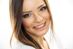 Beautiful woman face. Perfect toothy smile. Beautiful woman portrait smiling - isolated over a white background. Studio shot . Happy positive girl Royalty Free Stock Images