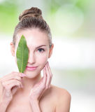 Beautiful woman face portrait with green leaf Royalty Free Stock Images