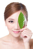 Beautiful woman face portrait with green leaf Royalty Free Stock Image