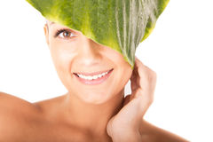 Beautiful woman face portrait with green leaf Royalty Free Stock Photography