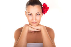 Beautiful woman  face portrait with red flowers Royalty Free Stock Image