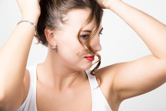 Beautiful woman face portrait with red lips, unruly curl Royalty Free Stock Photo