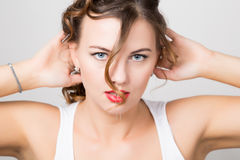 Beautiful woman face portrait with red lips, unruly curl Stock Photos