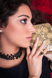 Beautiful Woman Face, profile, holding and old  box Stock Photo