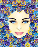 Beautiful woman face. A beautiful woman's face on the background of violets Stock Image
