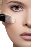 Beautiful woman face with skin foundation Stock Image