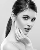 Beautiful woman face studio on white with sexy lips black and white Royalty Free Stock Photography