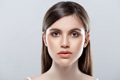 Beautiful woman face studio on white with sexy lips on gray background Stock Images